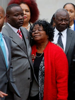 Judy Scott, center, Walter Scott's mother, is comforted by her son Rodney Scott after the mistrial was declared for the Michael Slager trial Monday Dec. 5, 2016, in Charleston, S.C.  Former patrolman, Slager, is charged with murder in the shooting death of Walter Scott last year.