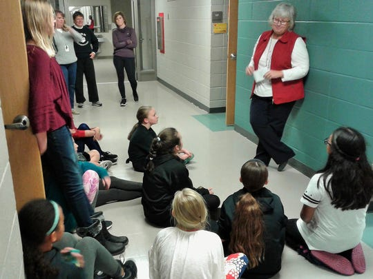 Principal Kristy Heffner briefs kids on the rules for