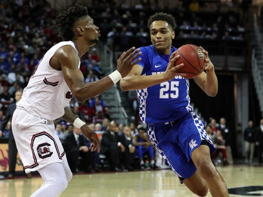 South Carolina Gamecocks forward Chris Silva (30) guards Kentucky Wildcats forward PJ Washington (25) as he drives to the goal during the first half at Colonial Life Arena in Columbia, South Carolina, on Tuesday, Jan. 16, 2018.