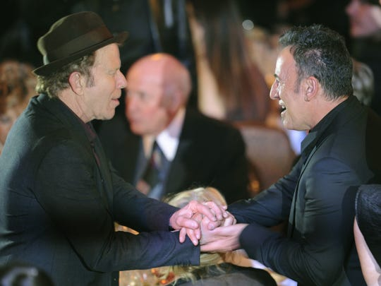 Tom Waits, left, greets Bruce Springsteen at the 2011 Rock and Roll Hall of Fame ceremony.