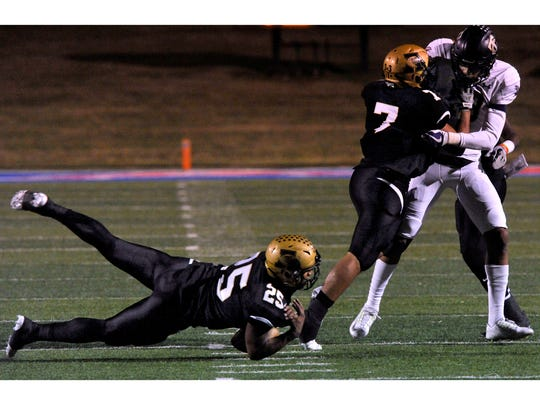 Abilene High School linebacker Devin Romero dives for the ball after teammates A.J. Gonzales and Raekwon Mills push back Timber Creek High School's Eric Ezukanma Friday Nov. 10, 2017. Abilene High won, 41-40.