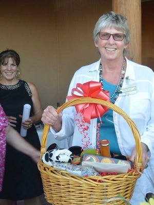 """Robyn Callo (pictured) was honored as Volunteer of the Year at Deming Animal Guardians' PetPourri Party on Friday, Sept, 22, 2016, at Luna Rossa Winery.  Raffle winners for the event were: $500 Peppers Supermarket gift card, Lois Grube; 21-speed men's mountain bike, Nancy Patterson; and Robert """"Shoofly"""" Shufelt print, Joe Jackson.  Over 100 attendees enjoyed refreshments, music and a fabulous silent auction at DAG's 25th anniversary celebration. Pictured in the back ground is Debbie Troyer."""