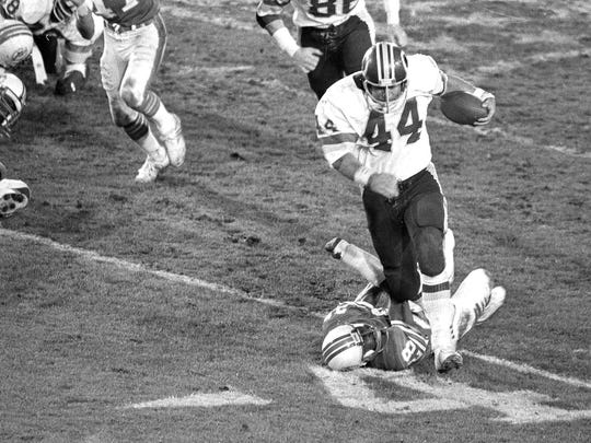 Jan. 30, 1983: Washington's John Riggins (44) breaks away from Miami on his way to a TD during the fourth quarter of Super Bowl XVII in Pasadena, Calif.