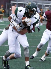 Groves senior receiver Nick Moore (front) hauled in