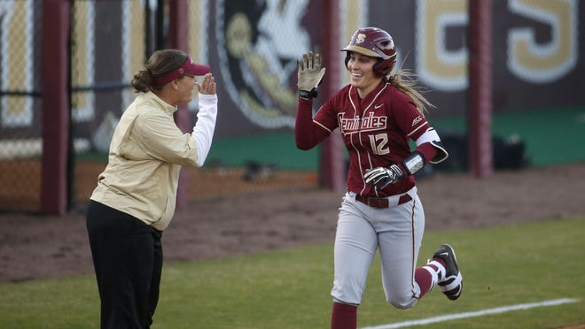 FSU's Carsyn Gordon gets a high five from coach Lonni Alameda after hitting a grand slam in the first inning during against Florida A&M earlier this year. The Rattlers and the Seminoles play each other for the third time this year in the NCAA tournament, which starts Friday.
