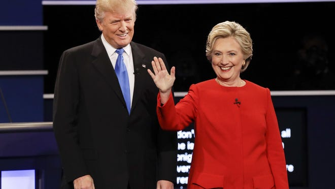 Republican presidential nominee Donald Trump and Democratic presidential nominee Hillary Clinton are introduced before their debate Monday, Sept. 26, 2016, at Hofstra University in Hempstead, N.Y.
