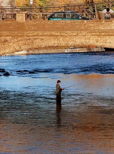 Jeloy Decker fishes next to the old Virginia Street bridge over the Truckee River.