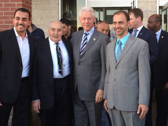 Bill Clinton visits Super Greenland Market in Dearborn on Sunday, Nov. 6, 2016. On Clinton's left is  the market's co-owner Haidar Koussan