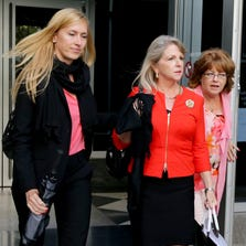 Former Virginia first lady Maureen McDonnell, center; her lawyer, Heather Martin, left; and an unidentified woman leave the federal courthouse Aug. 22, 2014, in Richmond, Va.