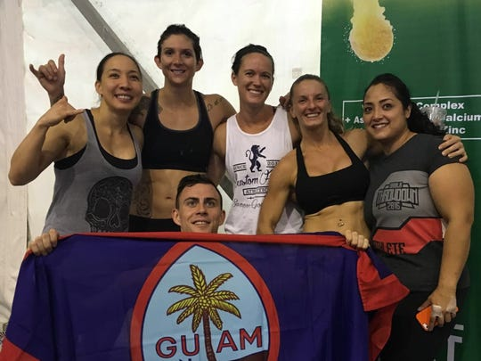 Six athletes from CrossFit Gof Metgot placed in the Top 10 at the Manila Throwdown. From left: Amy Reyes, Jessica Andrews, Sarah McCallum, Lindsay Summerhays and Melinda Sanchez. Holding Guam flag is Justin Kohn. Andrews, Reyes, McCallum and Kohn will represent Guam at the Asian Championships in South Korea in July.
