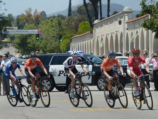 Leaders of the Amgen Tour of California turn from South Montgomery Street onto East Ojai Avenue during Stage 4 on Wednesday afternoon.