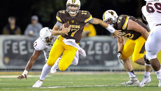 Wyoming quarterback Josh Allen returned to action for the first time in a year Saturday and had 315 yards of offense, two passing touchdowns and one rushing.