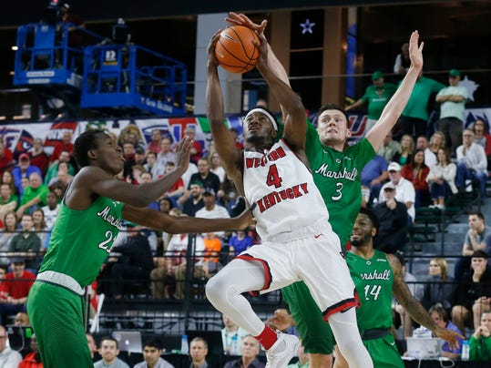 Marshall forward Darius George (21) and forward Jannson Williams (3) defend Western Kentucky guard Josh Anderson (4) during the first half of the Conference USA Men's Basketball Championship Game in Frisco, Texas, Saturday, March 10, 2018. (AP Photo/Michael Ainsworth)
