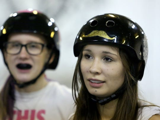 Miranda Patton, 17, listens as members of the Cherry Blossoms Jr Derby league practice on Tuesday Nov. 18, 2014 in Salem, Ore.