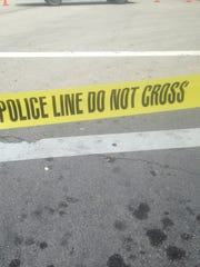 Police tape lines a street in Milwaukee.