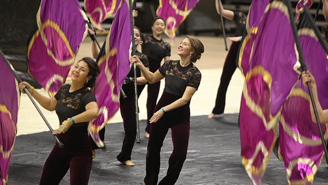 Members of Interplay, from Grand Rapids, Michigan, perform in the Mid East Color Guard Championship preliminaries at Cintas Center at Xavier University. The color guard unit performed to the song, 'Pi-R-Squared'. The group is under the direction of Bernie Stewart and Derek Smith. Cintas Center will be one of the venues when the WGI Color Guard World Championships take place April 3-5.