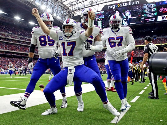 Jan 4, 2020; Houston, Texas, USA;  Buffalo Bills quarterback Josh Allen (17) celebrates after scoring a touchdown  during the first quarter ah] in the AFC Wild Card NFL Playoff game at NRG Stadium. Mandatory Credit: Kevin Jairaj-USA TODAY Sports
