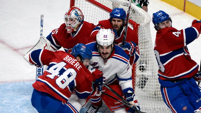 New York Rangers forward Brian Boyle (22) screens Montreal Canadiens goalie Dustin Tokarski (35) during the second period in game two.