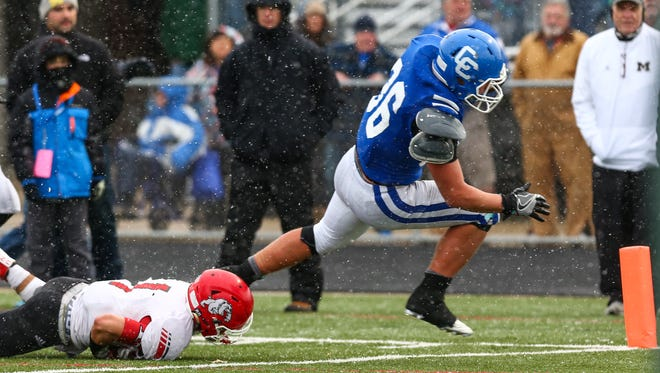 Catholic Central's Cameron Ryan (No. 36) gets around the corner on Romeo's Kade Messner en route to the Shamrocks first touchdown Saturday.