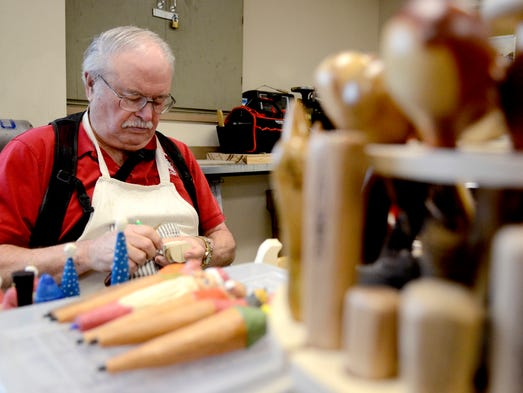 Dave Disselbrett works in his woodcarving club at the
