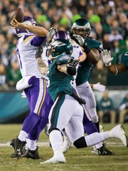 Defensive end Chris Long pressures Viking quarterback Case Keenum who throws an interception for a pick six.