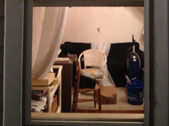 The window an intruder used to break into a home on Riddle Road in Woodlawn early Friday.