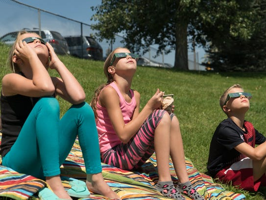 Students watch the solar eclipse Monday, Aug. 21, at
