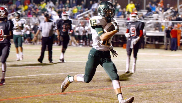 A.C Reynolds' Nathan St. Onge runs the ball for a touchdown