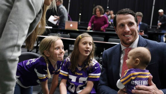 Minnesota Vikings linebacker Chad Greenway holds his