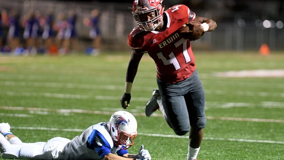 Erwin's Isaiah Poore escapes a West Henderson tackle