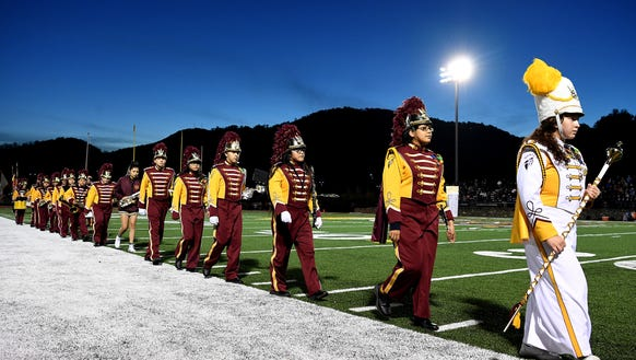 Members of the Cherokee band leave the field after