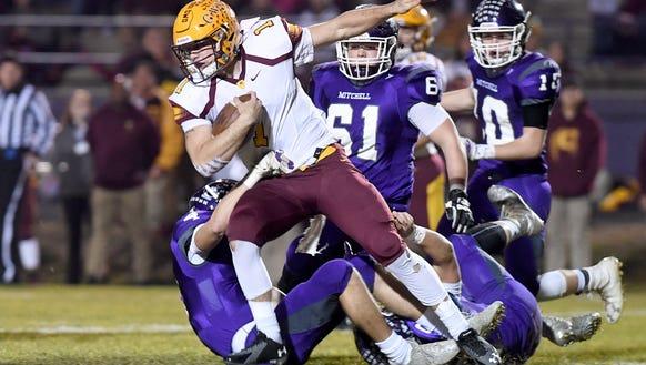 Cherokee quarterback Tye Mintz runs the ball as Mitchell's