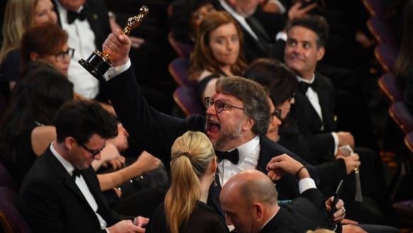 Guillermo del Toro showed off his first of two Oscars