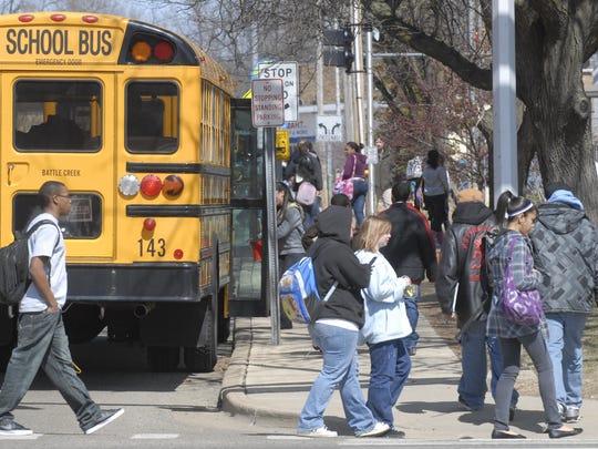 Battle Creek Public Schools buses on West Van Buren Street.