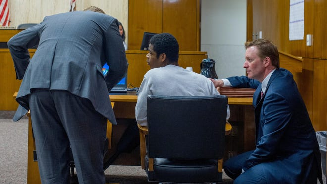 Jermontay Brock, center, talks with his attorneys, chief public defender Nate Bach, left, and first assistant public defender Kevin Lowe, during a hearing before Circuit Court Judge Paul Gilfillan on Thursday at the Peoria County Courthouse. Brock, 16, has been charged with first-degree murder in the April 2018 killing of two people at an off-campus party near Bradley University.