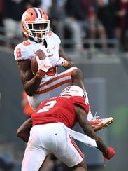 Clemson wide receiver Deon Cain (8) catches a pass over NC State cornerback Mike Stevens (2) during the 3rd quarter on Saturday, Nov. 28, 2017 at Clemson's Memorial Stadium.