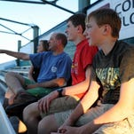 Kevin Kraus, second from left, and his wife Sue, left, and sons Kyle, second from right, and Bennett watch the Great Falls Voyagers play the Helena Brewers Saturday night.
