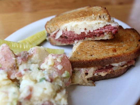 A classic pastrami Reuben is on the menu at Kenny and Zuke's Delicatessen. The deli bakes its own rye bread, pickles the sauerkraut and smokes the pastrami in house.