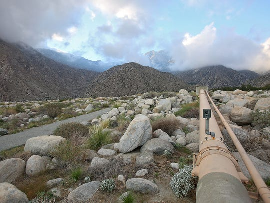 A camera is mounted on a Desert Water Agency pipe where the Pacific Coast Trail diverts from the access road that the agency controls in Snow Creek Canyon, Tuesday, September 16, 2014.
