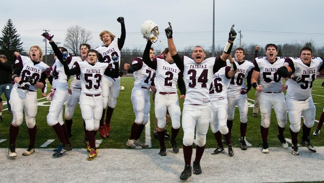 BFA-Fairfax players celebrate their 42-30 win in the Division III football championship football game against Otter Valley on Saturday.