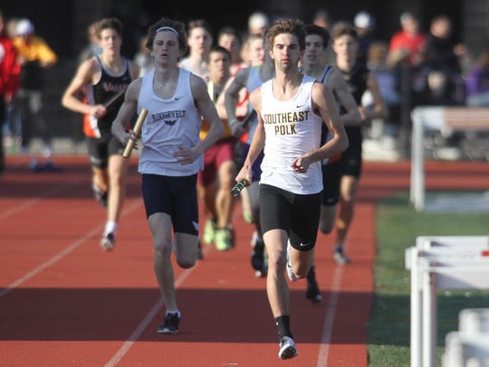 Southeast Polk's Matt West leads the pack on the first