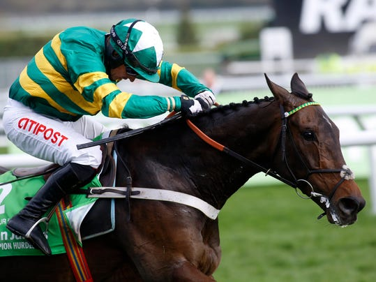 Buveur D'Air and Noel Fehily lead the field to the finish line to win The Stan James Champion Hurdle Race during Champion Day of the 2017 Cheltenham Festival of horse racing at Cheltenham Racecourse, England Tuesday March 14, 2017. (Julian Herbert/PA via AP)