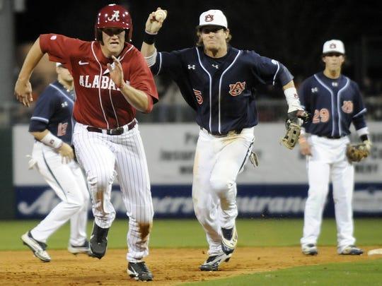 Auburn second baseman Creede Simpson chases down Alabama