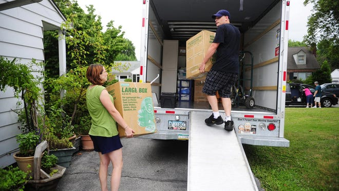 Jenn Nagle and Matt Schwartz load a U-Haul truck with boxes from Schwartz's mother's Springettsbury Township home, in whose basement they had been living for more than a year with their 8-month-old son Houston and Schwartz's three older children, in July 2012.