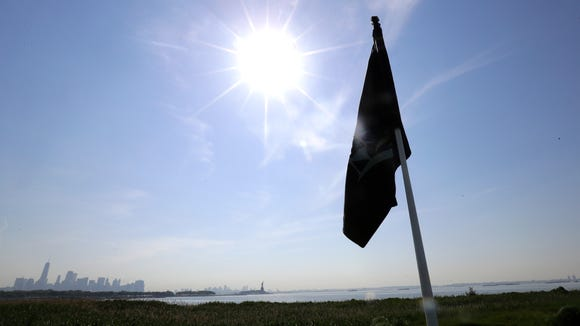 FILE - In this June 13, 2017, file photo, the sun shines at Liberty National Golf Club   in Jersey City, N.J., which will host the Presidents Cup in late September. (AP Photo/Julio Cortez, File)