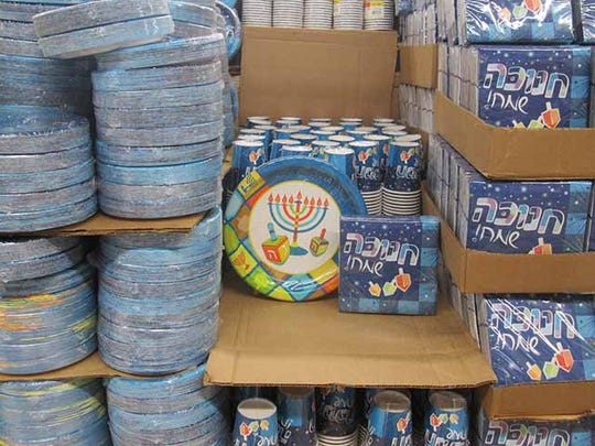 During the week leading up to Hanukkah, Osher Ad, a large Jerusalem supermaket, displayed entire aisles of Hanukkah products, from menorahs and candles to Hanukkah-themed paper plates and chocolate coins.