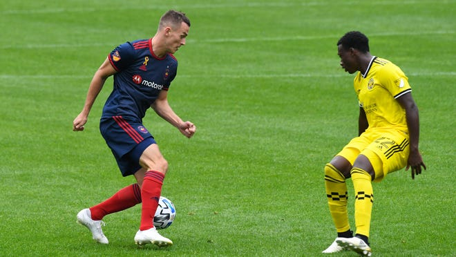 Chicago Fire defender Boris Sekulic (2) brings the ball upfield against Columbus Crew midfielder Derrick Etienne (22) during the first half on Saturday at Soldier Field in Chicago.