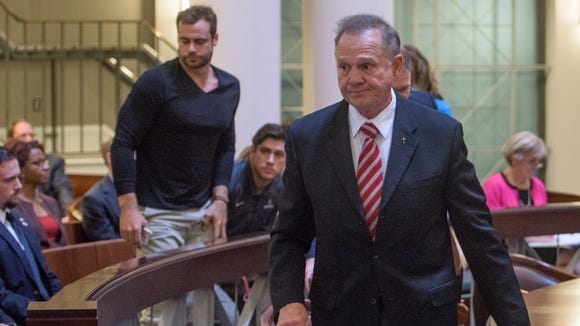 Roy Moore walks out of the Supreme Court Chamber before the lottery is held to pick the judges who will hear Roy Moore appeal in Montgomery, Ala. on Thursday October 27, 2016.