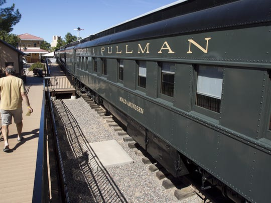 People walk by the Roald Amundsen Pullman Car at the