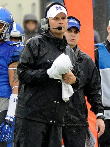 Memphis coach Justin Fuente watching the game during
